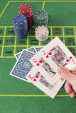 Holding hands with poker cards Stock Image