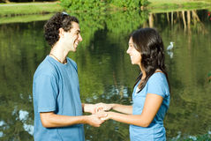 Holding Hands by a Pond. - Horizontal Stock Image