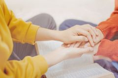 A holding hands,Prayer together concept. Mentor holding hands encouraged and prayer together Royalty Free Stock Photography