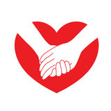Holding hands on red heart. Royalty Free Stock Photo