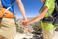 Holding hands romantic couple hiking Grand Canyon Stock Photo