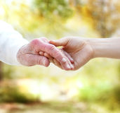 Holding hands with senior Stock Photography
