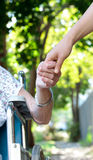 Holding hands with senior lady Royalty Free Stock Image