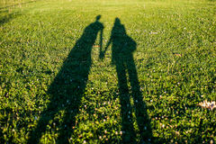 Holding hands. Shadow of a couple holding their hands royalty free stock photo