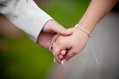 Holding hands together Stock Photos