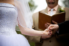 Holding hands during a wedding ceremony Stock Photo