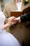 Holding hands during a wedding ceremony Stock Photos