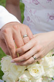 Holding hands with wedding rings Royalty Free Stock Image