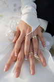 Holding hands with wedding rings Stock Photos