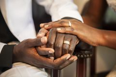 holding hands wedding rings royalty free stock photo