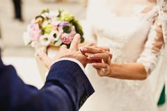 Holding hands with wedding rings Royalty Free Stock Images