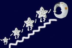 Holding hands white star go up the stairs to sleeping moon in silver bonnet on navy blue background.  Stock Images