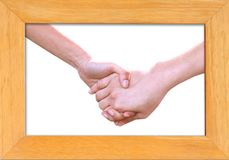Holding hands in wood frame isolated Stock Images