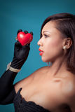 Holding a heart Stock Images