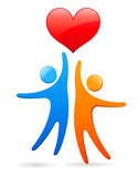 Holding a heart. Big red held by two human figures Stock Image
