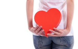 Holding heart behind back Royalty Free Stock Images