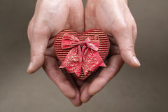Holding a heart shaped box stock images