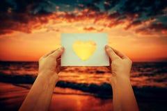 Holding heart symbol stock photos