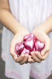 Holding hearts Stock Photos