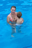 Holding Her Daughter in the Pool Stock Photos