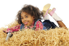 Holding Her Gun in the Hay Stock Image
