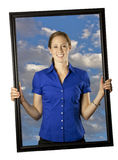 Holding Her Own. A business woman holding her own picture up Royalty Free Stock Images