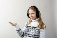 Holding in his hand. Girl dressed in a white sweater holding something in his hand Stock Photography