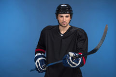 Holding hockey-stick Royalty Free Stock Photos