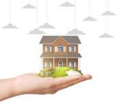 Holding home model. Loan concept stock photos
