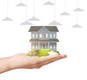 Holding home model. Loan concept royalty free stock image