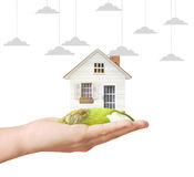 Holding home model. Loan concept royalty free stock photo