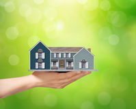 Holding home model, loan concept Stock Photo