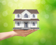 Holding home model, loan concept Royalty Free Stock Photo