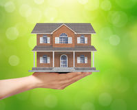 Holding home model, loan concept Royalty Free Stock Image