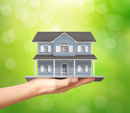 Holding home model, loan concept Royalty Free Stock Photos
