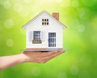 Holding home model, loan concept Stock Photos