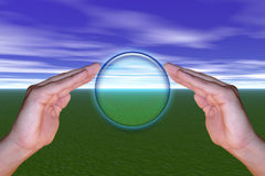 Holding the hope. Holding a sphere of hope with both hands with a nature green background under a cloudy colorful sky. Illustration Stock Photo