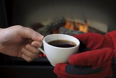 Holding hot coffee. Giving and receiving a coffee during winter time Stock Image