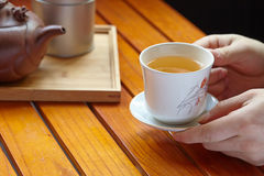 Holding hot cup of tea Stock Images