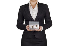 Holding a house Stock Image