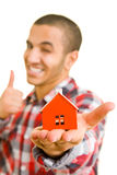 Holding a house Stock Images
