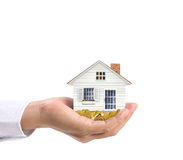 Holding house and coins Royalty Free Stock Image