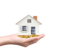 Holding house and coins Royalty Free Stock Images