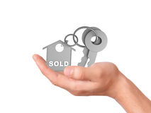 Holding house keys. sold concept Stock Images