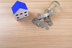 holding house representing home ownership and the Real Estate bu Stock Image