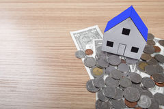 holding house representing home ownership and the Real Estate bu Stock Photos
