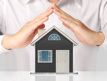 Holding house representing home ownership Stock Images