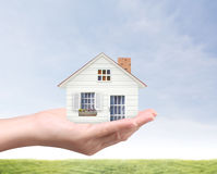 Holding house representing home ownership Stock Photography