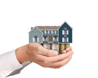 Holding house representing home ownership Stock Photos