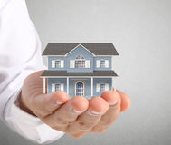 Holding house representing home ownership Royalty Free Stock Photo